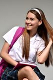 Catholic Colombian Female Student With Long Hair Wearing School Uniform With Books