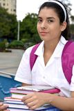 Serious Cute Girl Student Wearing School Uniform. A young pretty Colombian teenage girl Stock Photo
