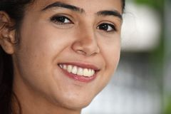 Smiling Face Of Cute Colombian Teenager Girl. A young pretty Colombian teenage girl stock image