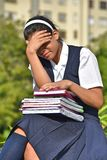 Unhappy Catholic Colombian Female Student Wearing School Uniform With Books