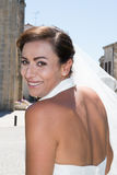 Young pretty and confident bride in classic white veil in the city Royalty Free Stock Images