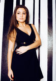 Young pretty cool fat brunette woman with long hair fashion dressed in little black dress happy smiling, lifestyle Stock Photo