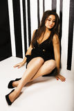 Young pretty cool fat brunette woman with long hair fashion dressed in little black dress happy smiling, lifestyle Royalty Free Stock Photos