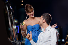 Young pretty couple in a casino Royalty Free Stock Photography