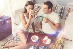 Young pretty couple drinking morning coffee together royalty free stock photography