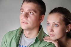 Young pretty couple looking somewhere into the dis Stock Photography