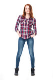 Young pretty curly woman in plaid shirt Stock Image