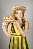 Young pretty easter woman with colourfull eggs Stock Photography