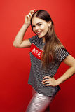 Young pretty emitonal posing teenage girl on bright red background, happy smiling lifestyle people concept royalty free stock photos