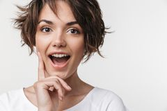 Young pretty excited shocked woman posing isolated over white wall background royalty free stock photo