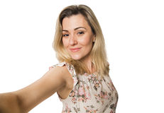 Young pretty fashion blonde woman taking self shot photo. Selfie Royalty Free Stock Images