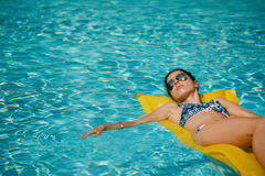 Young pretty fashion woman body posing in summer in pool with cl Royalty Free Stock Photography