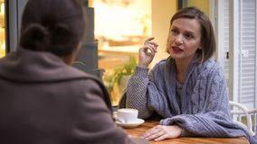 Young pretty female discussing problems with her best friend, trustful relations. Stock photo stock image