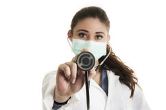 Young pretty female doctor wearing a mask and Royalty Free Stock Image