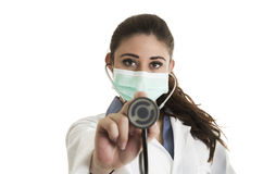 Young pretty female doctor wearing a mask and Royalty Free Stock Photo