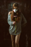 Young pretty female wearing respirator, allergy concept Royalty Free Stock Photo