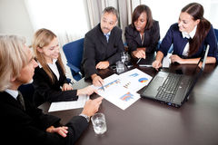 Young pretty females with mature business managers Stock Photos