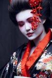 Young pretty geisha in kimono Stock Image
