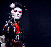 Young pretty geisha in kimono with sakura and decoration Royalty Free Stock Images