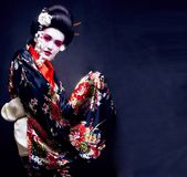 Young pretty geisha in kimono with sakura and decoration Royalty Free Stock Photo