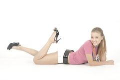 Young pretty girl. Pretty young woman is lying over white Royalty Free Stock Image
