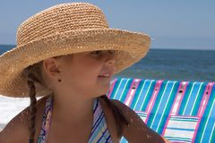 Young pretty girl. A cute little girl wearing a hat at the beach royalty free stock photography