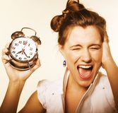 Young pretty girl with alarm clock Royalty Free Stock Images
