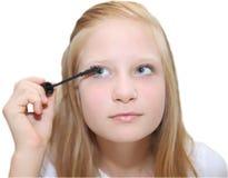 Young pretty girl applying mascara Stock Image