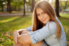 Young pretty girl in autumn park, close-up Stock Images