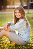 Young pretty girl in autumn park Royalty Free Stock Photo