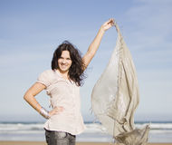 Young pretty girl beach. A young pretty girl with a scarf in a beach in a sunny beach Stock Photography
