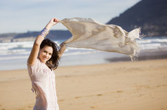Young pretty girl beach. A young pretty girl with a scarf in a beach in a sunny beach Stock Photo