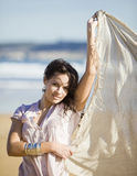 Young pretty girl beach. A young pretty girl with a scarf in a beach in a sunny beach Stock Images