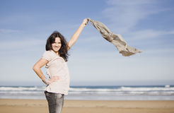 Young pretty girl beach. A young pretty girl with a scarf in a beach in a sunny beach Royalty Free Stock Photos