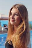 Young pretty girl in bikini in outdoors pool. Stock Photos