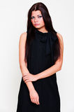 Young pretty girl in black dress Stock Photography