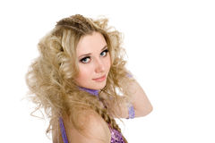 Young pretty girl with blond curly hair Royalty Free Stock Image