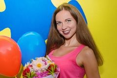 Young pretty girl brunette smiling and holding a bouquet of flow stock images