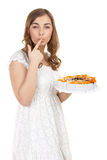 Young pretty girl with a cakes Stock Images