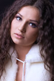 Young pretty girl close-up portrait in fur coat Stock Photos