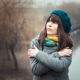 Young pretty girl in cold weather outdoors. Vintage portrait Stock Photography