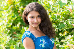 Young pretty girl with  curly hair outdoors Stock Photography