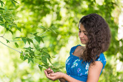 Young pretty girl with  curly hair outdoors Royalty Free Stock Photo