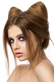 Young pretty girl with cute cat ears hairstyle Royalty Free Stock Images