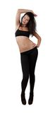 Young pretty girl dancing in leggings and top. Isolated white Royalty Free Stock Images