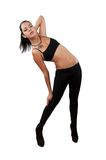 Young pretty girl dancing in leggings and top. Isolated white Royalty Free Stock Photography