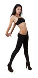 Young pretty girl dancing in leggings and top. Isolated white Royalty Free Stock Image