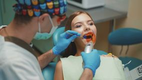 Young pretty girl is in dental cabinet on treatment and dental cleansing. 4K. Young pretty girl is in dental cabinet on treatment and dental cleansing 4K stock footage