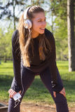 Young pretty girl doing exercise and running in the park Royalty Free Stock Photography