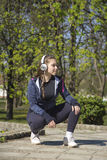 Young pretty girl doing exercise and running in the park Royalty Free Stock Image
